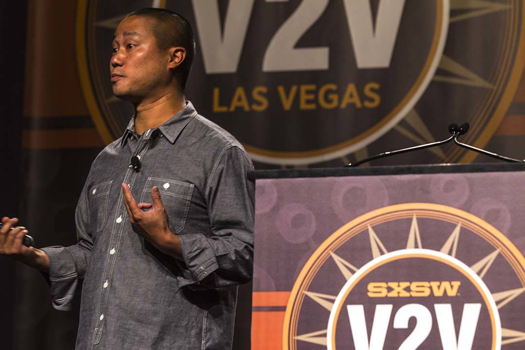 Zappos.com CEO and Downtown Project head Tony Hsieh speaks during his keynote at SXSW V2V meeti ...