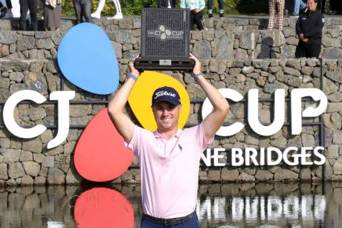 Justin Thomas of the United States holds up his trophy after winning the CJ Cup PGA golf tourna ...