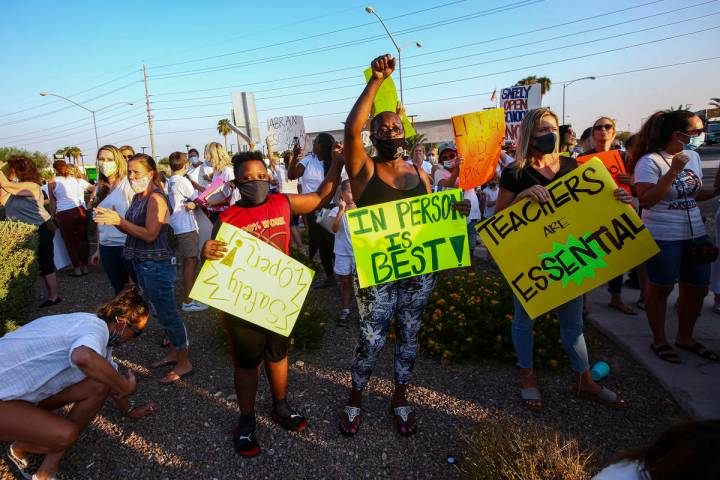 Shelly Davis, center, with her son, James Davis, 12, participates in a demonstration in support ...