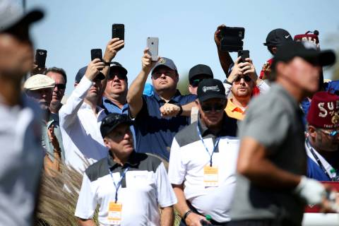 Fans take phone photos Kevin Na and Phil Mickelson on the fifth hole during second round of Shr ...