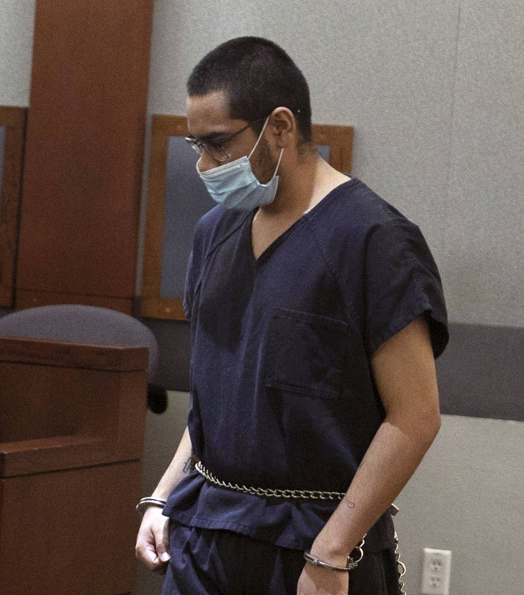 Edgar Samaniego, charged in the shooting of a Las Vegas police officer, is led into the courtro ...