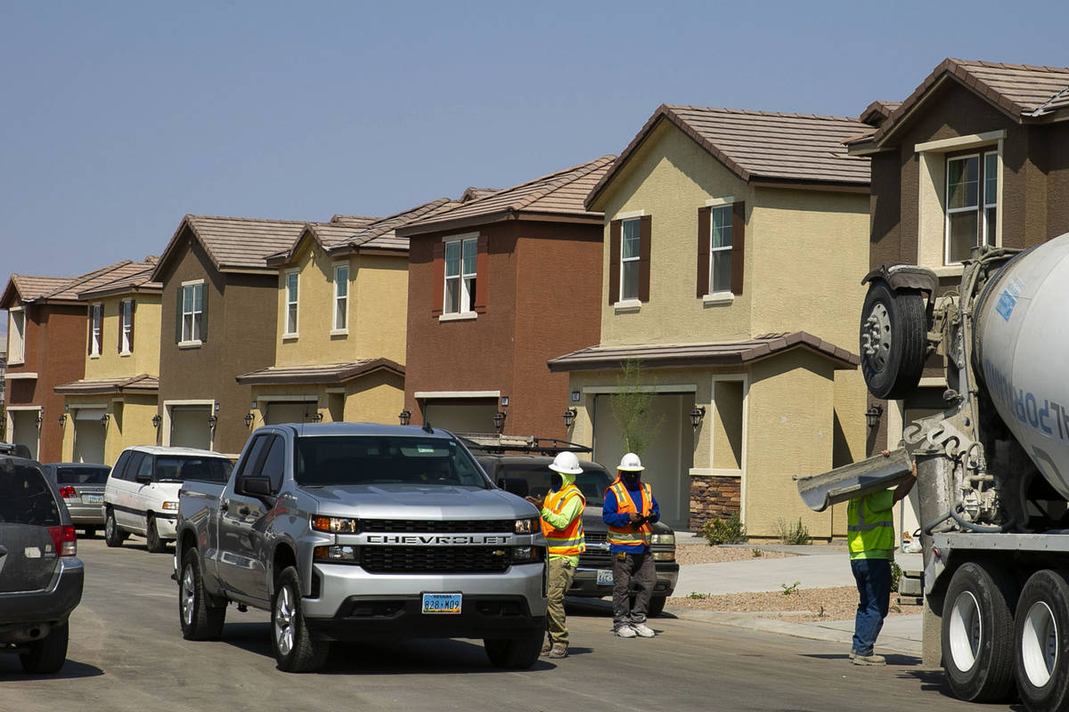 Construction workers are seen at a single-family-housing rental project called Cactus Cliff on ...