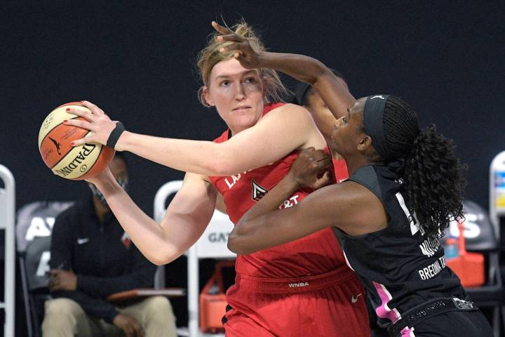 Las Vegas Aces center Carolyn Swords, left, is guarded by Dallas Wings center Astou Ndour, righ ...