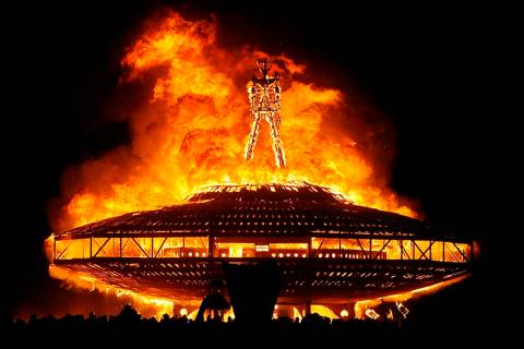 "The ""Man"" burns on the Black Rock Desert at Burning Man festival near Gerlach in 2013. (Andy B ..."