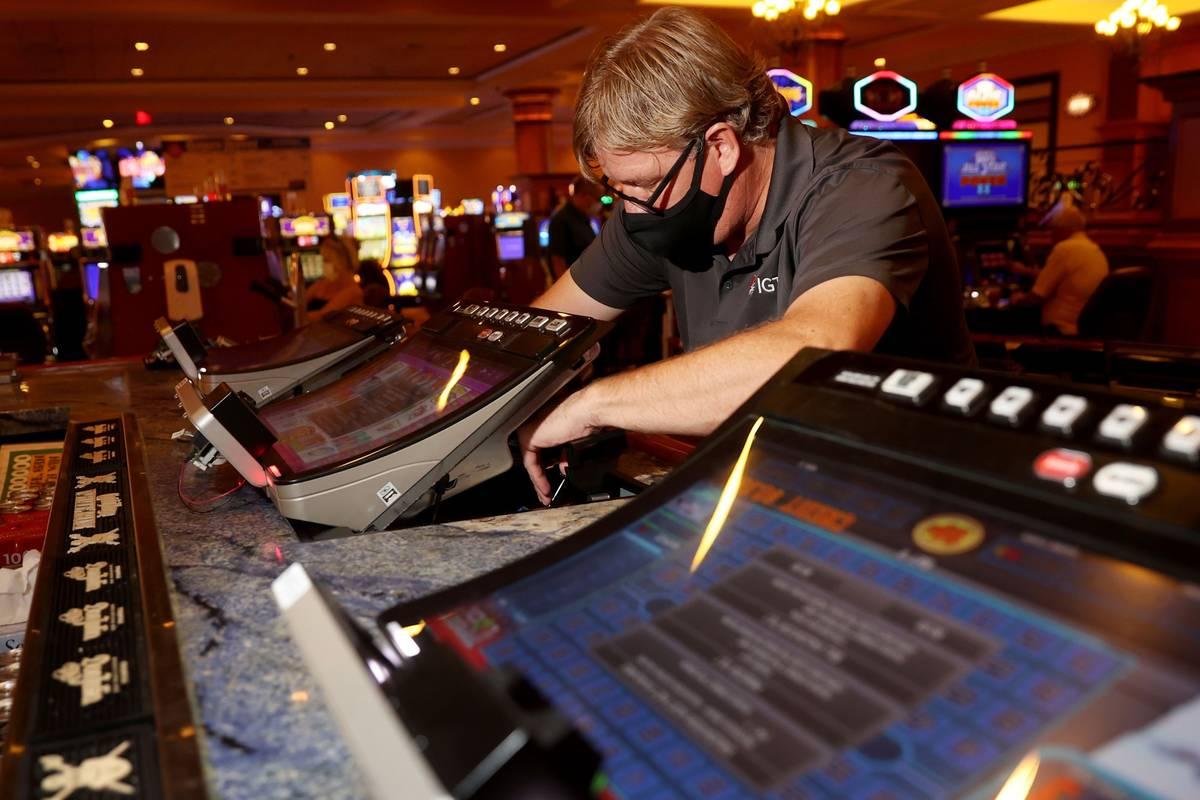 International Game Technology technician Tommy Esposito instalsl PeakBarTop slot machine cabine ...