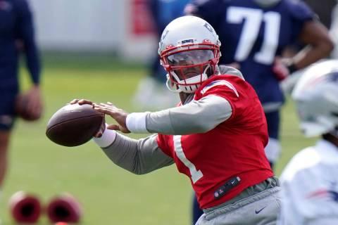 New England Patriots quarterback Cam Newton (1) winds up for a pass during an NFL football trai ...