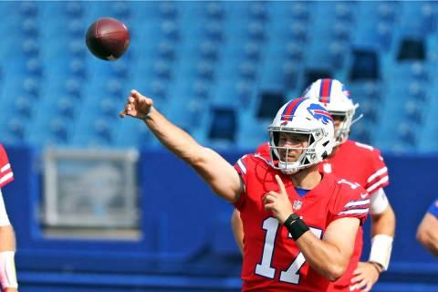 Buffalo Bills quarterback Josh Allen throws a pass during pregame warmups in the ninth day of N ...