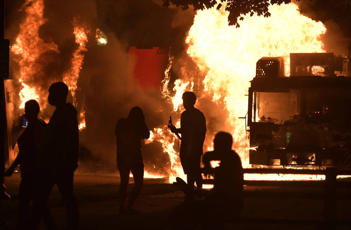Garbage and dump trucks were set ablaze on Sunday, Aug. 23, 2020 by rioters near the Kenosha Co ...