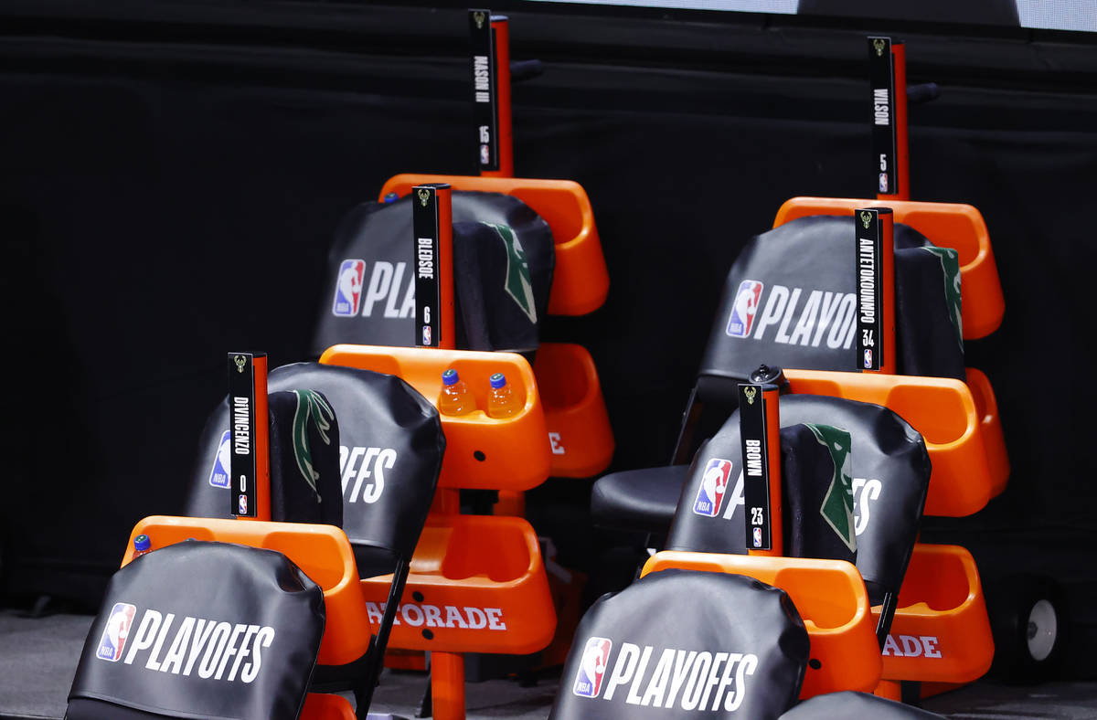 The Milwaukee Bucks bench sits empty at game time of a scheduled game between the Milwaukee Buc ...