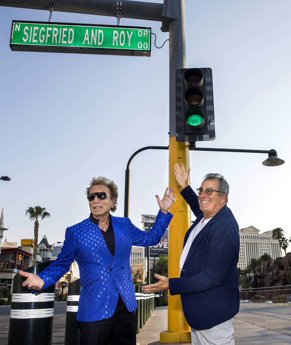 Siegfried Fischbacher, left, joined by Kenny Ortega along the Strip as the Mirage porte cochere ...
