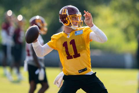 Washington quarterback Alex Smith (11) throws the ball during practice at the team's NFL footba ...