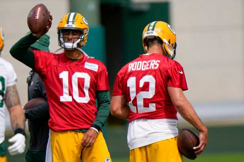 Green Bay Packers' Aaron Rodgers (12) and Jordan Love (10) are seen during NFL training camp Sa ...