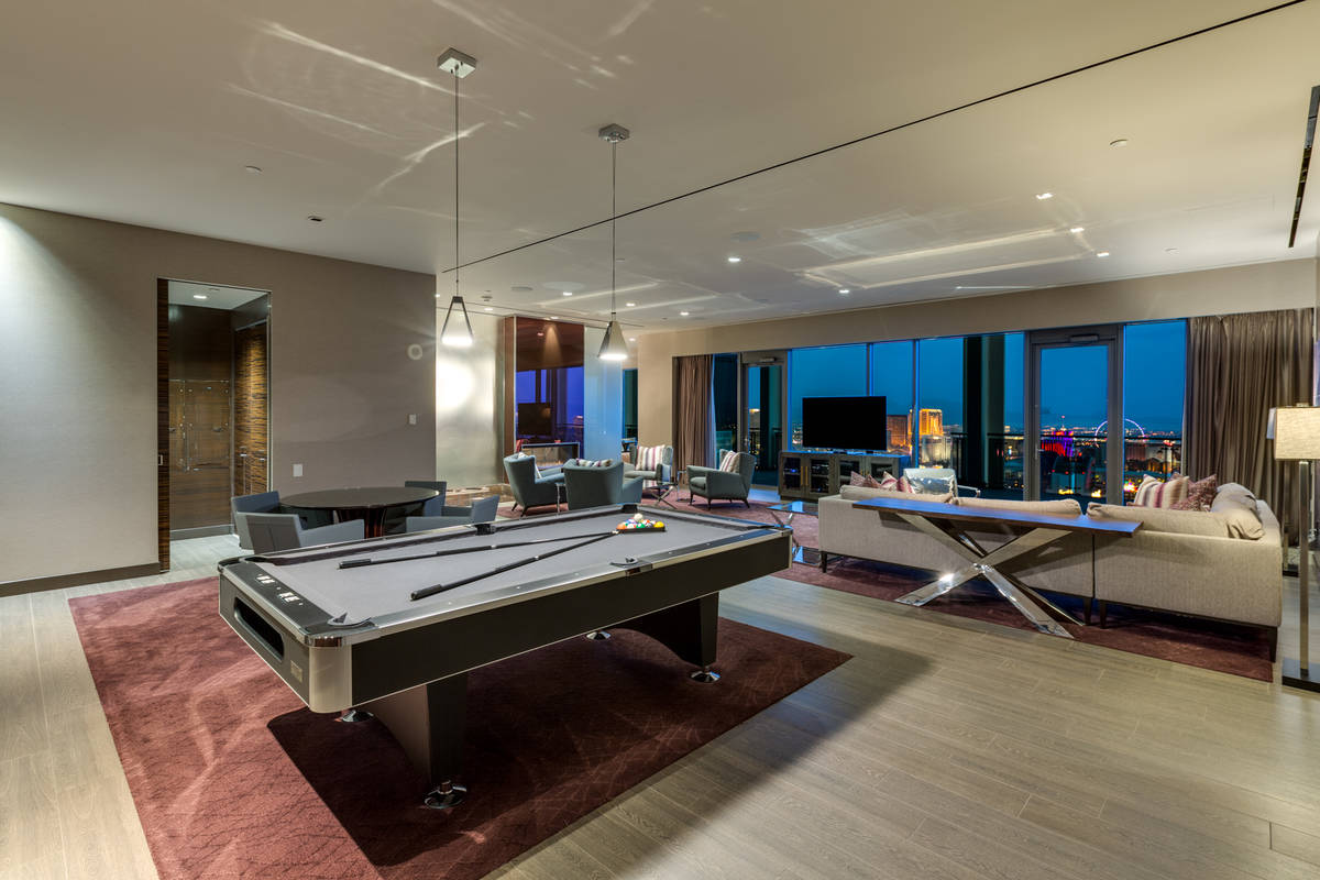 The 3,300-square-foot Palms Place penthouse features an open floor plan with an entertainment a ...