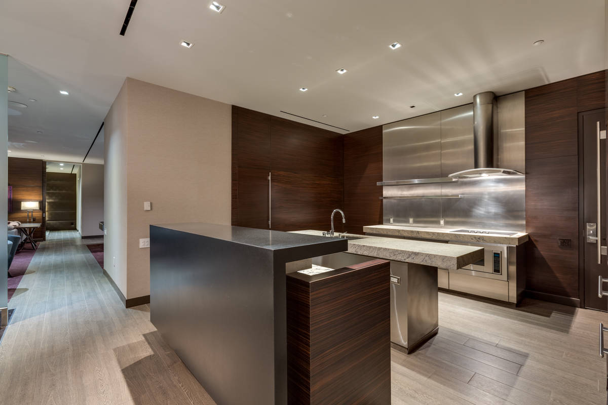 The kitchen features double islands with upgraded granite counters. (Luxury Estates International)