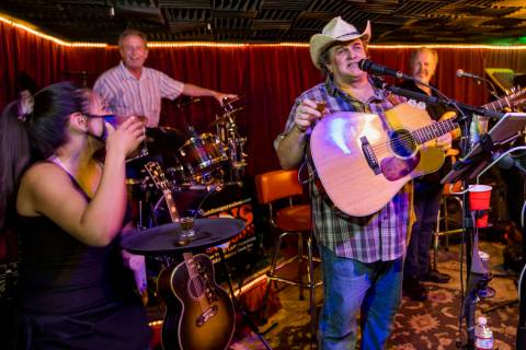 Owner Bobby Kingston, right, says a toast as he plays with his band on the final night before S ...