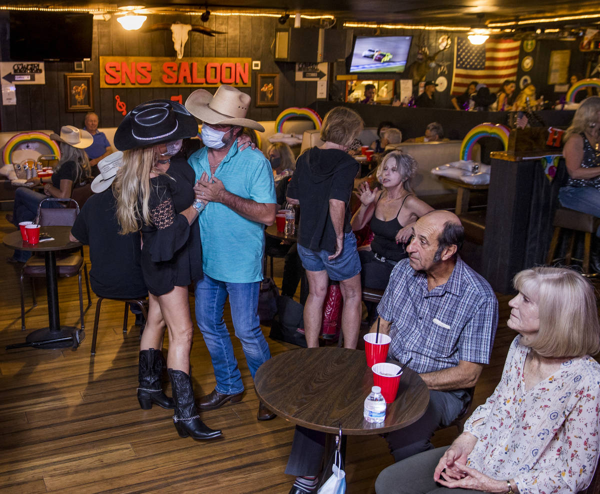Patrons drink and take to the floor as owner Bobby Kingston plays with his band on the final ni ...