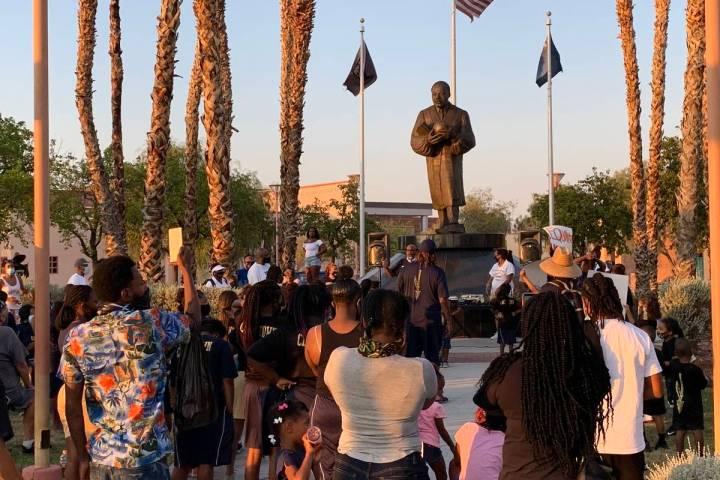 The children huddled in to hear Byron Goynes, the Martin Luther King Jr. Senior Center's progra ...