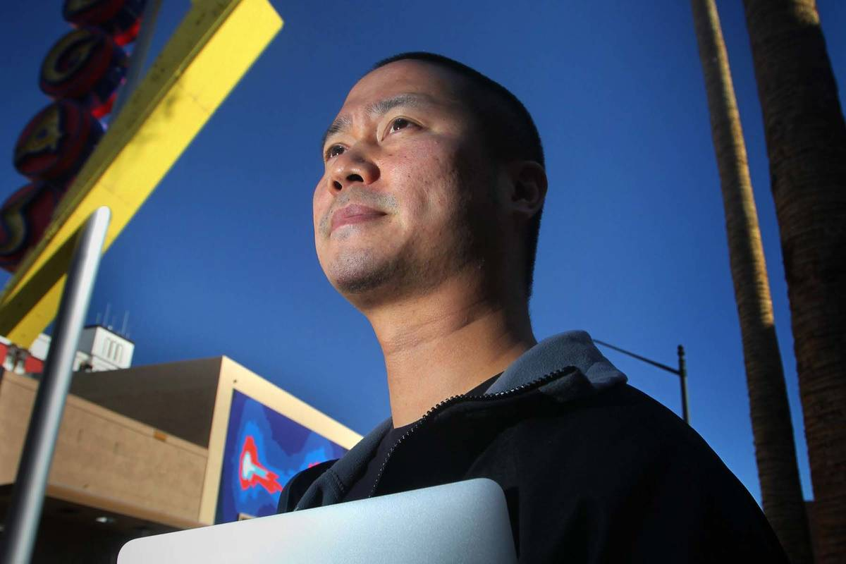 Tony Hsieh stands near a Vegas neon sign in downtown Las Vegas on Friday, Feb. 3, 2012. (Jeff S ...