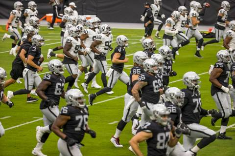Las Vegas Raiders QB Derek Carr (4) runs with teammates during warm ups for a scrimmage at Alle ...