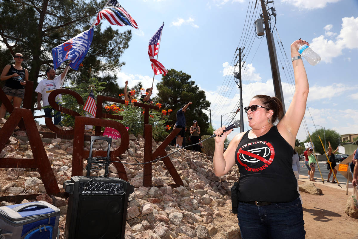 Melissa Blundo, organizer for No Mask Nevada PAC, speaks during a No Mask Nevada PAC rally at S ...