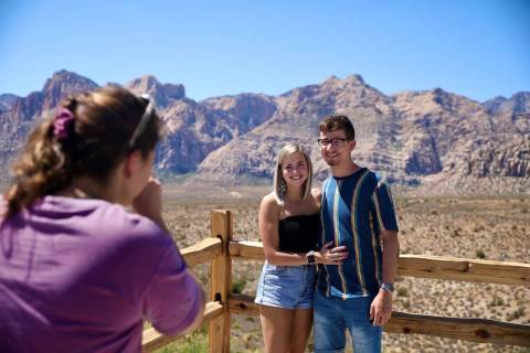 Brianna Shultz, from left, of Las Vegas, takes a photo of her friends Jennah Smith and Cole Len ...