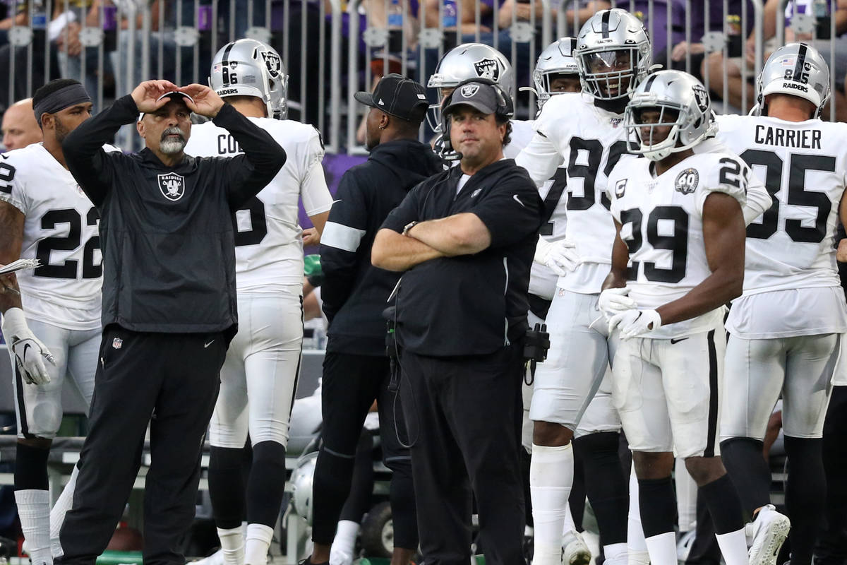 Oakland Raiders special teams coordinator Rich Bisaccia grabs his hat as defensive coordinator ...