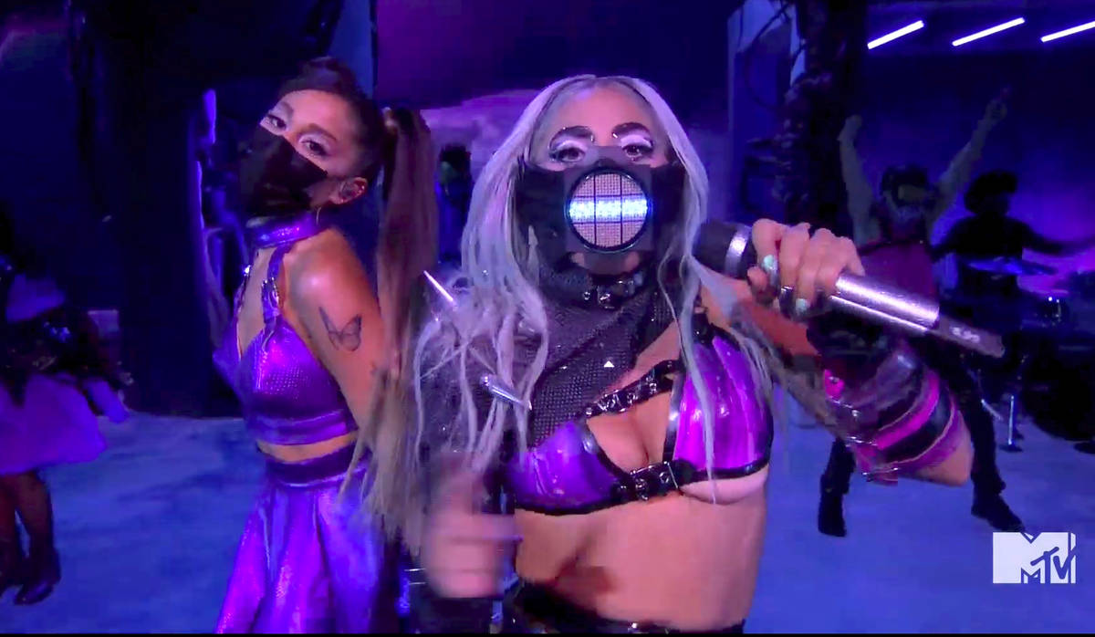 In this video grab issued Sunday, Aug. 30, 2020, by MTV, Ariana Grande, left, and Lady Gaga per ...