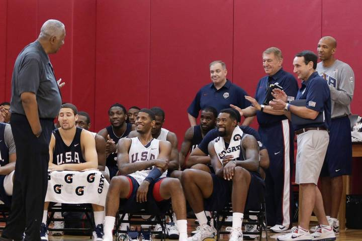 John Thompson, center, a former Georgetown and Olympic men's basketball coach, talks with playe ...
