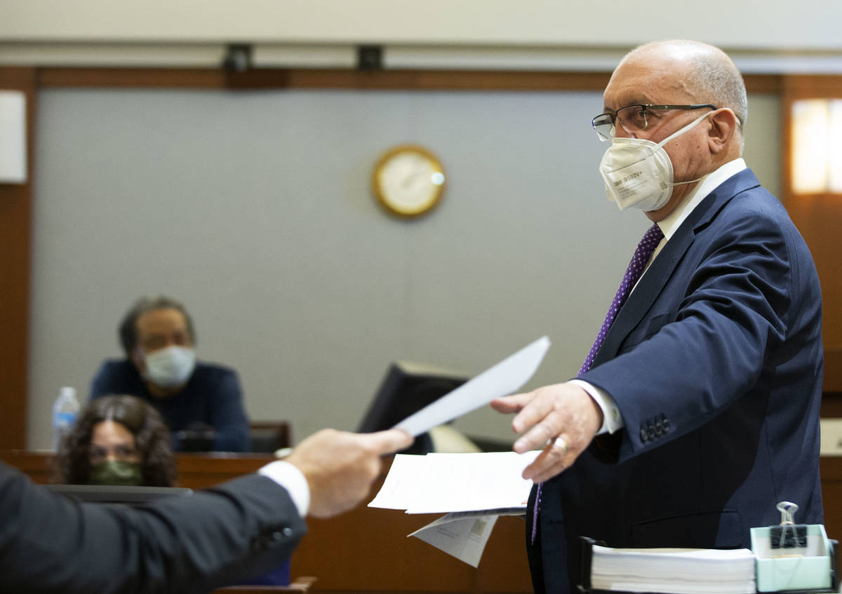 Attorney Dominic Gentile, who is defending Adolfo Orozco in the Alpine fire case, exchanges pap ...