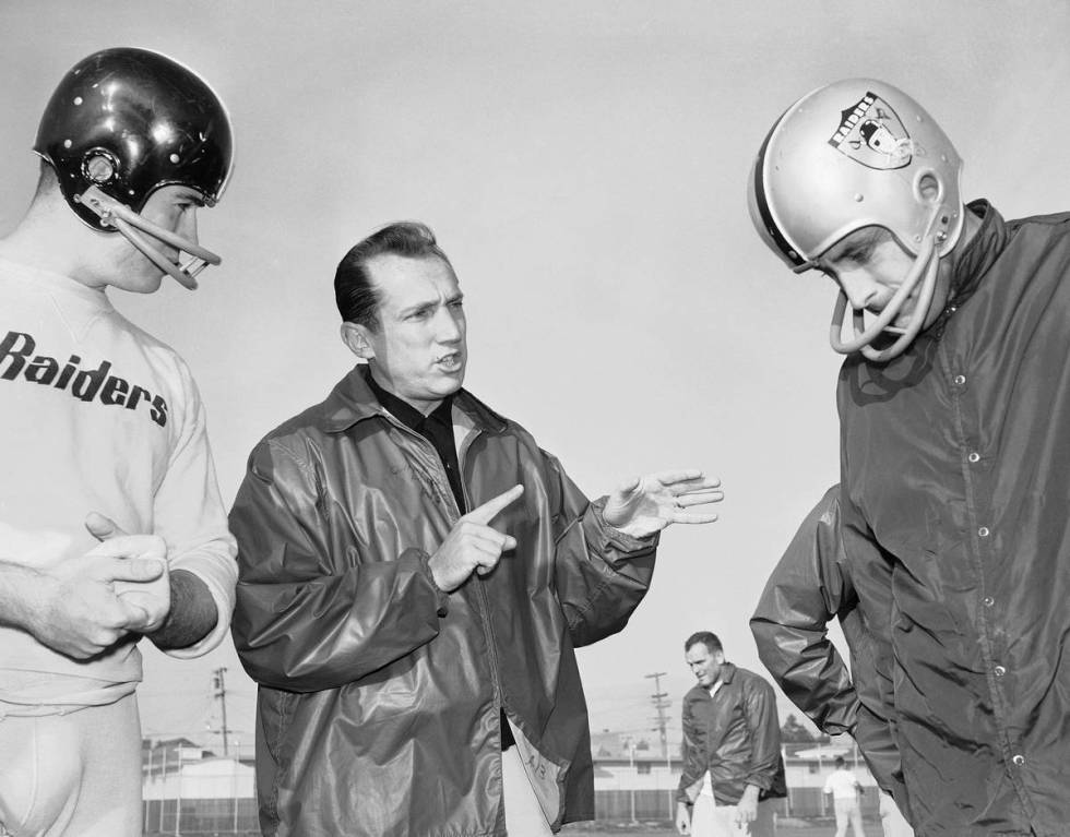 Raiders coach Al Davis talks with players during a practice in 1963 in Oakland. (The Associated ...
