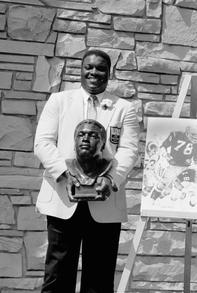 Former Oakland Raiders great Art Shell poses with his bust after being inducted into the Footba ...