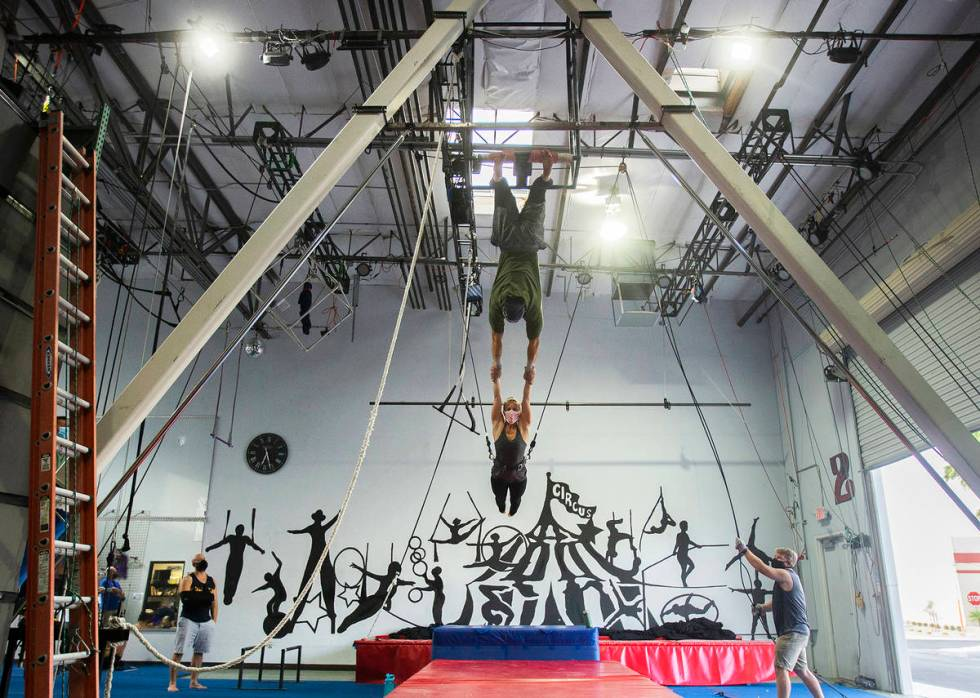Aerialist-turned-fundraiser Caroline Lauzon rehearses with Felipe Bellomo at Trapeze Las Vegas. ...