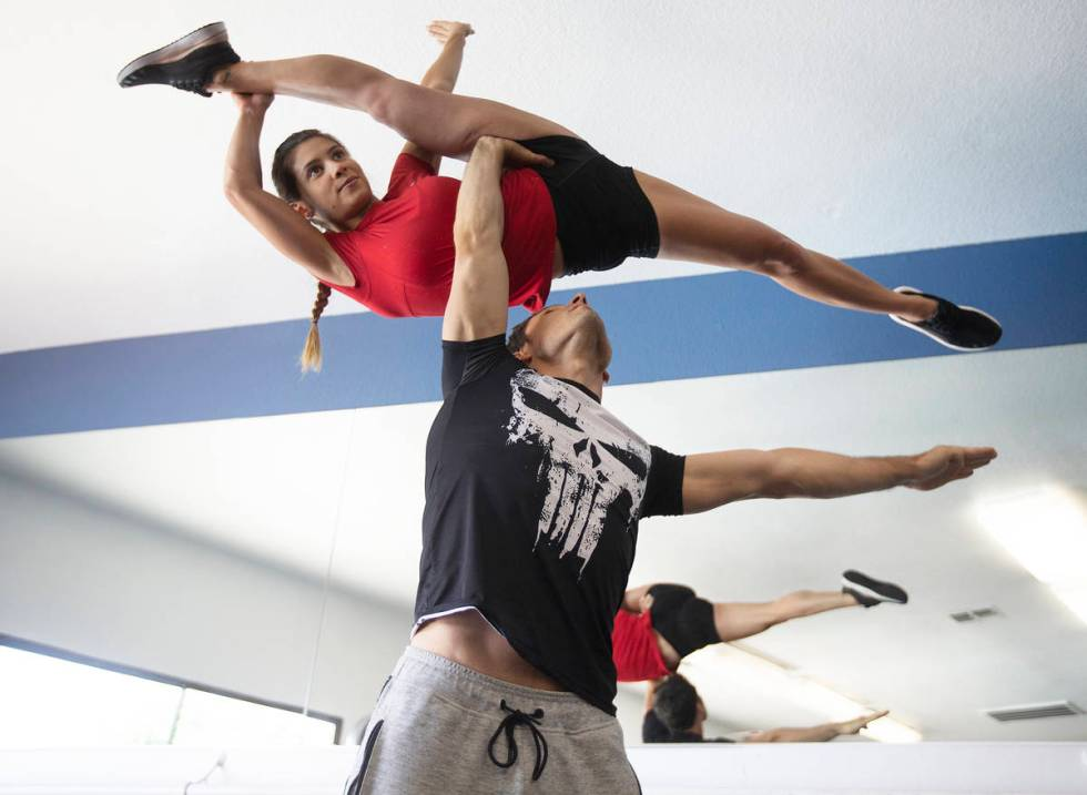 Lucas and Monize Altemeyer work out at their apartment gym in June. He struggled for months to ...