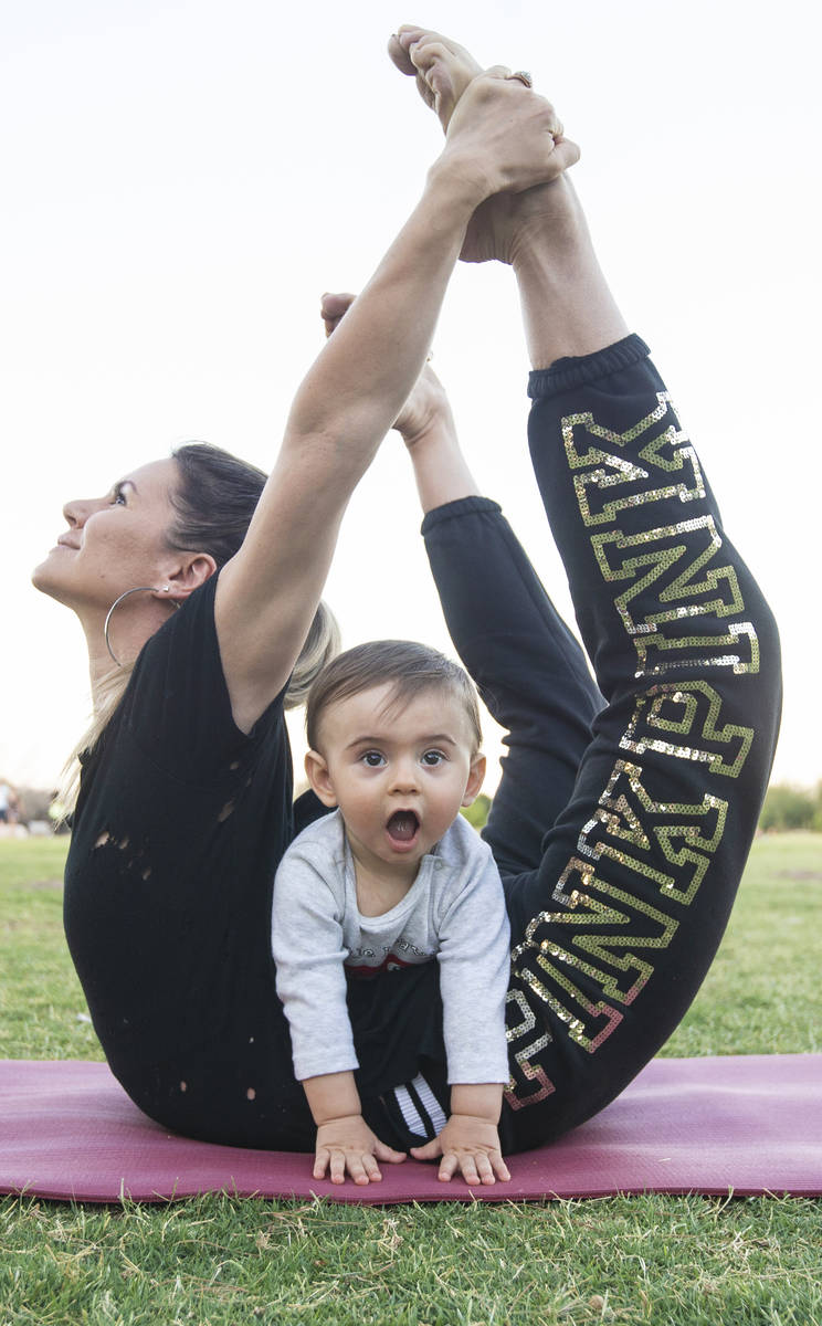 Luba Kazantseva stretches with her son Theodoros at Sunset Park in June. (Benjamin Hager/Las Ve ...
