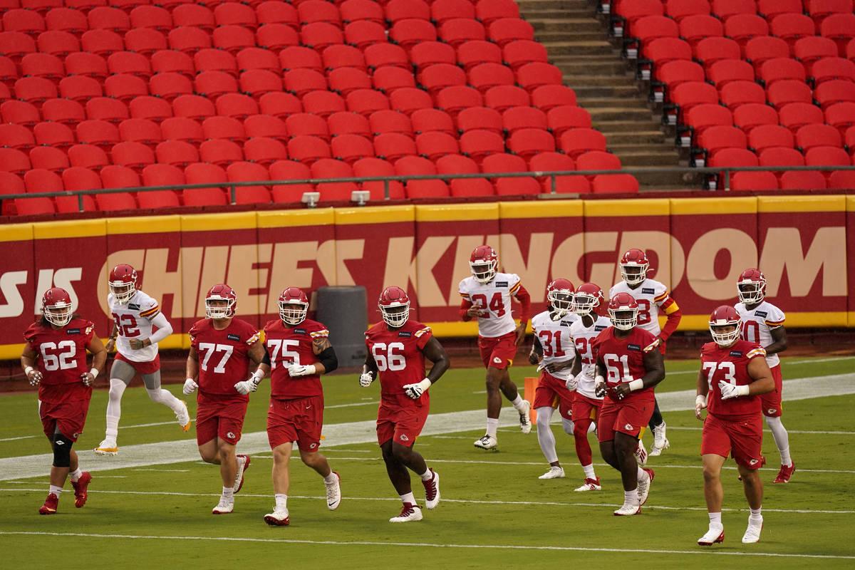 Kansas City Chiefs players run during NFL football training camp Saturday, Aug. 29, 2020, at Ar ...