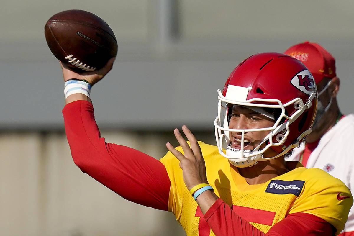 Kansas City Chiefs quarterback Patrick Mahomes passes during an NFL football training camp prac ...