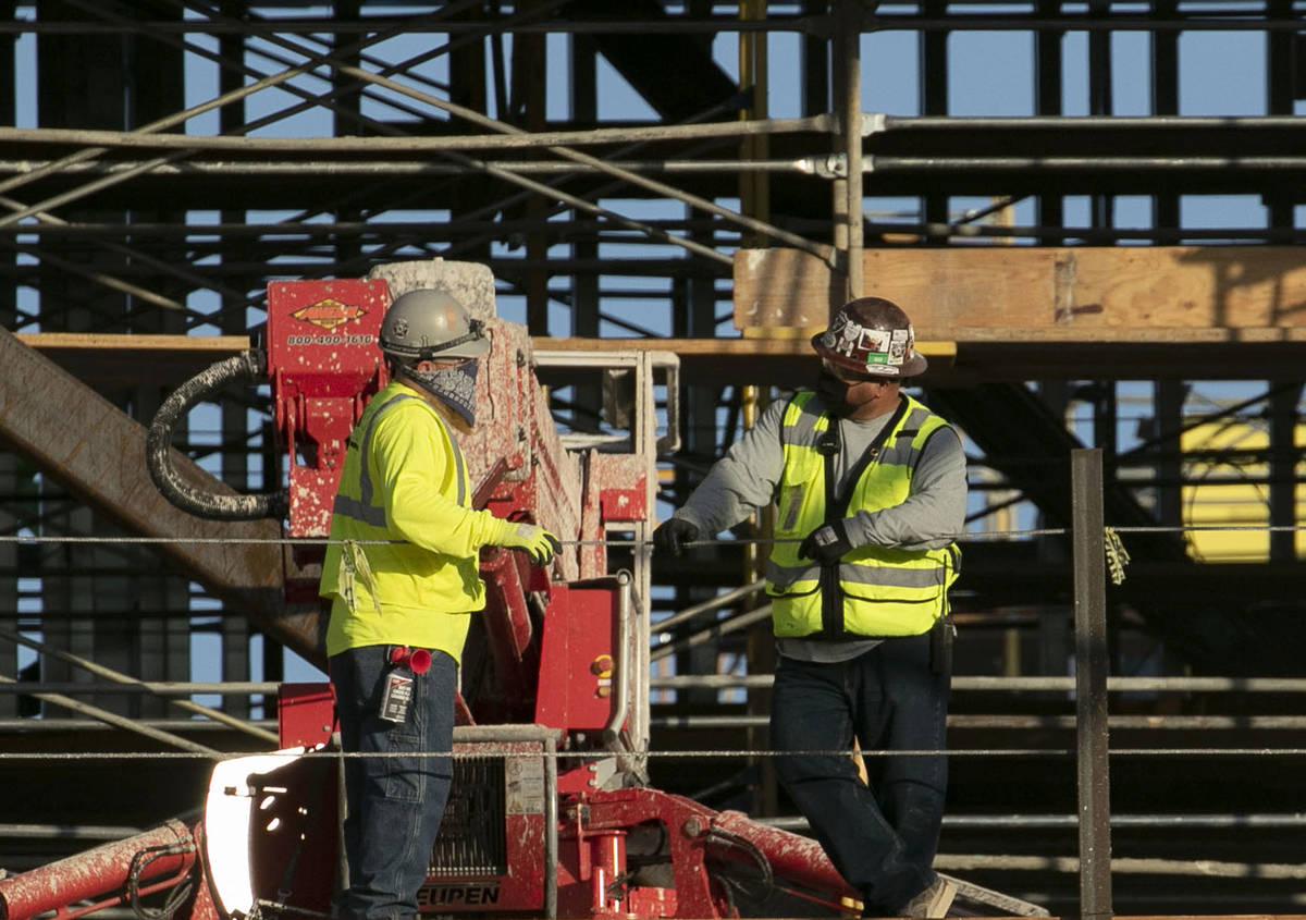 Construction workers chat at the Resorts World construction site, on Monday, Aug. 31, 2020, in ...