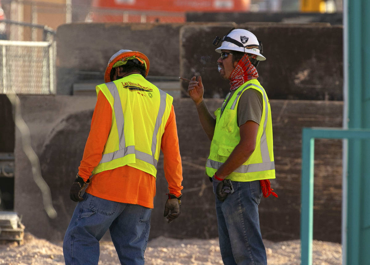 Construction workers take a break at the Resorts World construction site, on Monday, Aug. 31, 2 ...