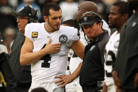 Oakland Raiders quarterback Derek Carr (4) speaks with head coach Jon Gruden on the sideline du ...