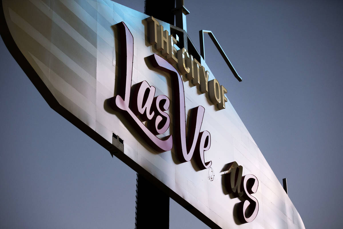 """The lettering to spell """"The City of Las Vegas"""" is in process on the 80-foot-tall arch ..."""