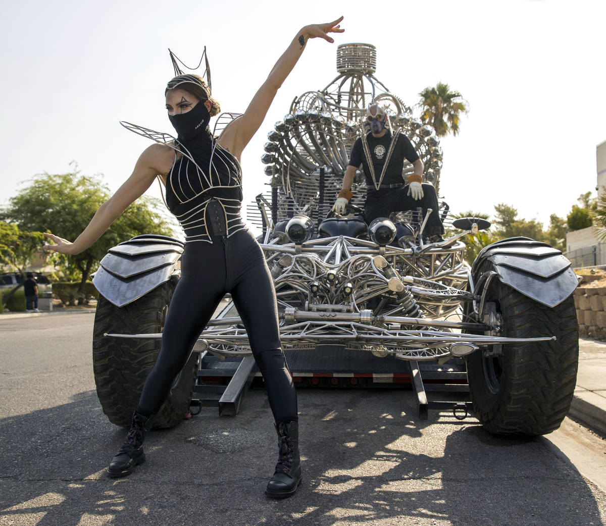 Joli Irvine, left, joins artist Henry Chang with kinetic art car Valyrian Steel as they prepare ...
