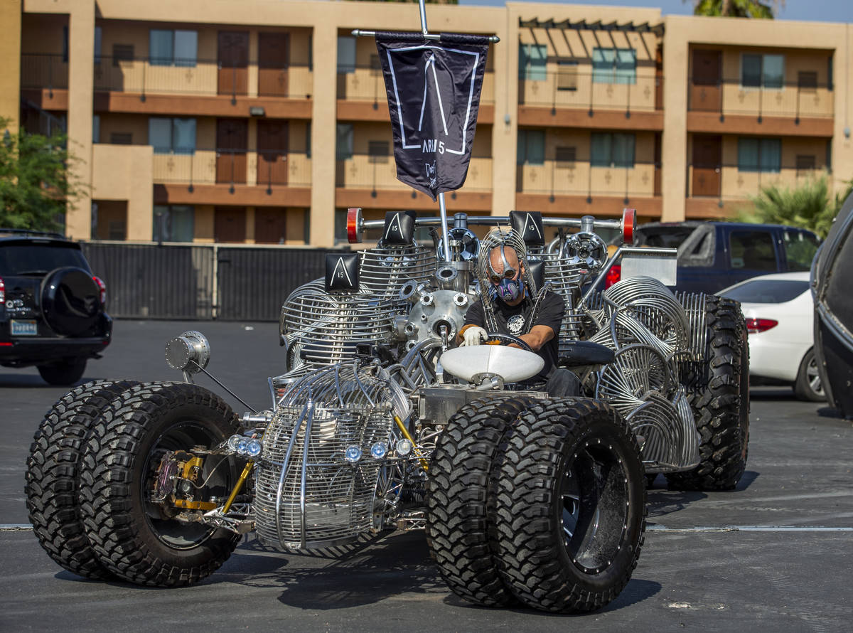 Artist Henry Chang behind the wheel of his kinetic art car Mister Fusion at his studio preparin ...