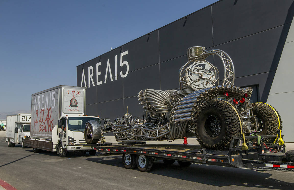 Artist Henry Chang's kinetic art car Valyrian Steel on a flatbed trailer apart of a caravan at ...
