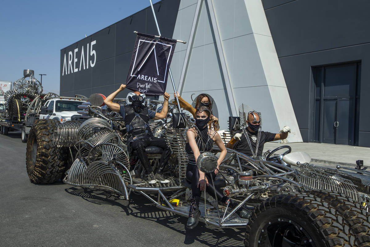 Artist Henry Chang, right, behind the wheel of his kinetic art car Mister Fusion leading a cara ...