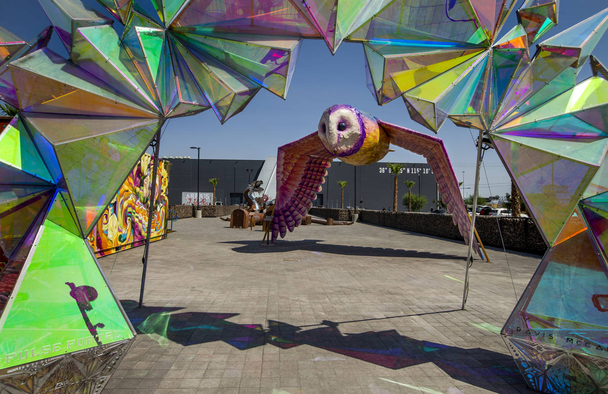 Artwork outside of Area15 is the background for a caravan including Henry Chang's art cars, an ...