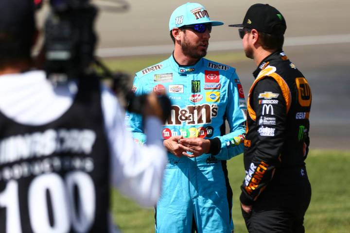 Kyle Busch, left, talks with Kurt Busch before qualifying for the Monster Energy NASCAR Cup Ser ...