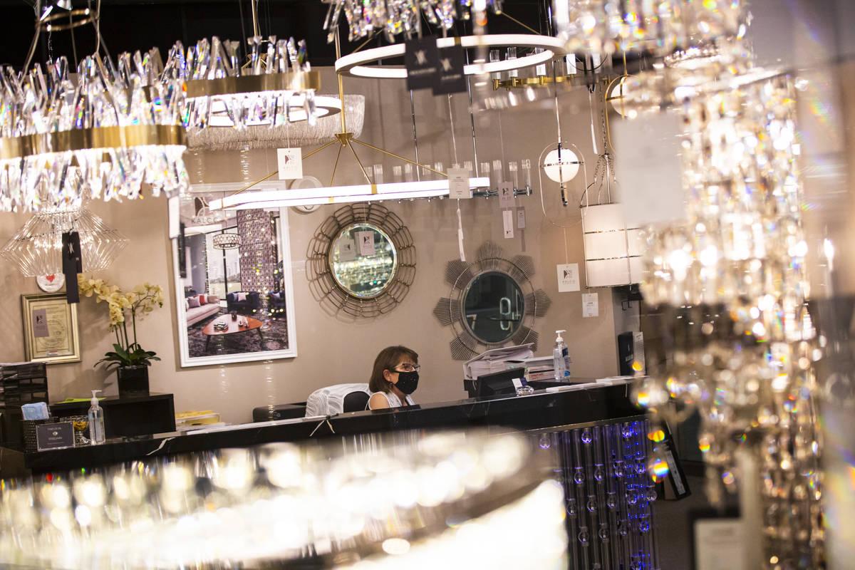 Michelle Gurschke, showroom manager for Allegri by Kalco Lighting, works at her desk during the ...