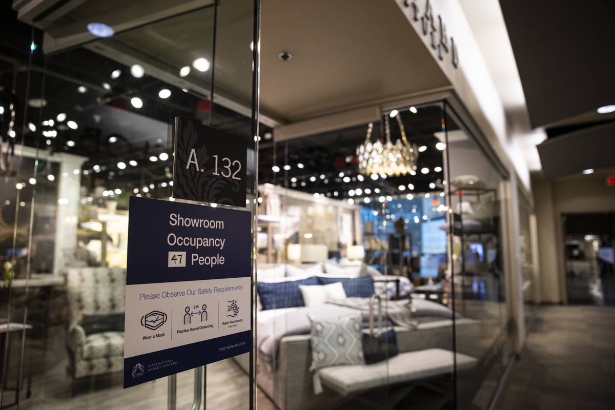 A sign with safety requiremens is seen outside of a showroom at the Summer Las Vegas Market at ...