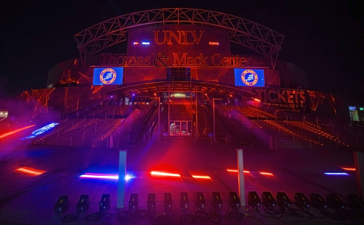 The Thomas and Mack Center glows red as part of a show of solidarity with live events workers i ...