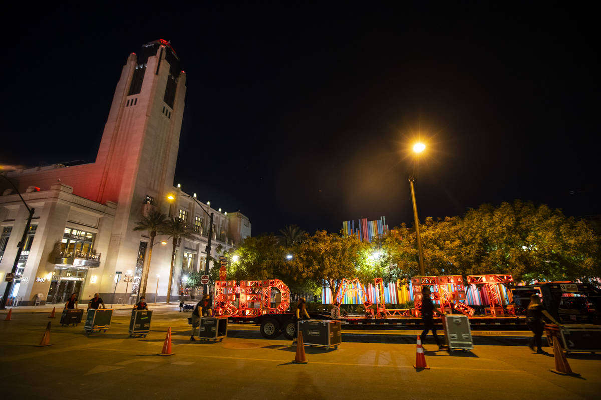 """Entertainment workers push road cases past a """"Red Alert"""" sign as The Smith Center tur ..."""